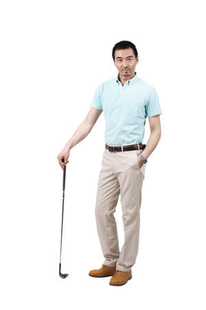 Young man wearing a suit and golfing