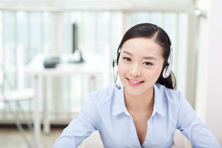 Female office worker wearing headset,portrait