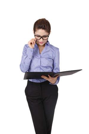 Businesswoman holding a portfolio Stock fotó