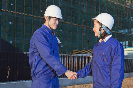 architects shaking hands in site