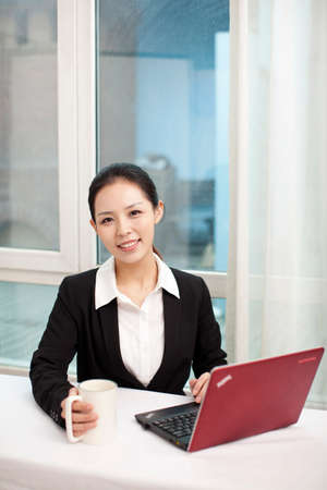 Portrait of a businesswoman sitting in front of a laptop