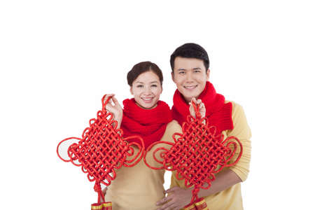 Portrait of young couple holding Chinese knots celebrating the Spring Festival
