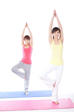 Portrait of two female friends exercising yoga