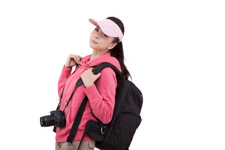 Portrait of a young female with a camera, carrying backpacker