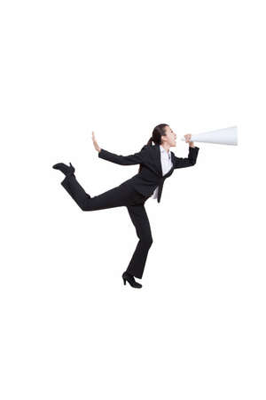 Portrait of young businesswoman shouting into a megaphone