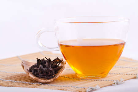Oolong Tea and dried tea leaves Stock Photo