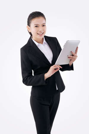 Oriental fashion business woman using tablet