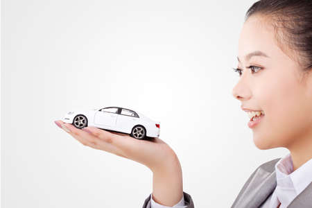 Oriental business woman with car model