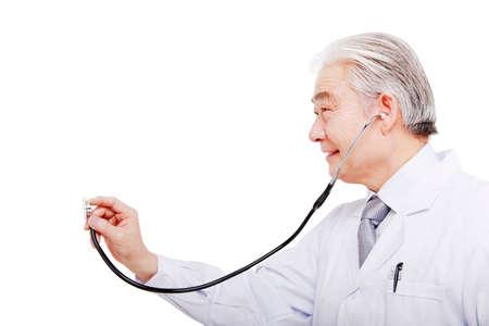 The doctor with auscultate closeup Banco de Imagens