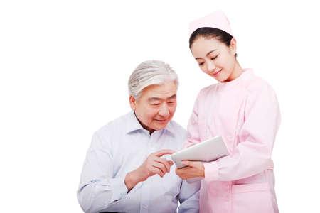 Nurses guide patients using tablet