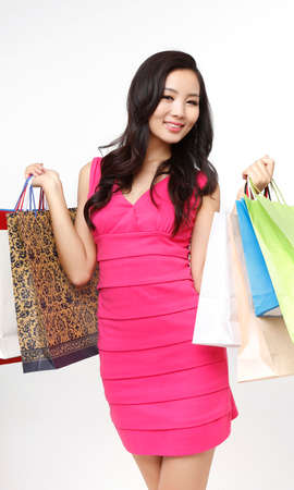 Fashion young woman holding shopping bags