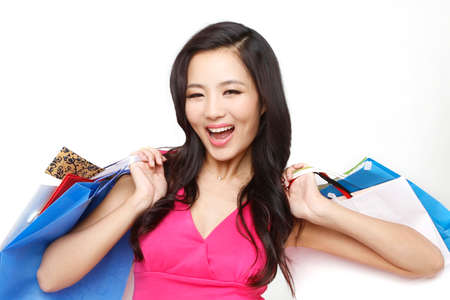 Fashion young woman holding shopping bags