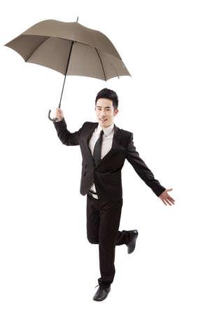 Business people holding umbrella 版權商用圖片