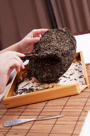 Professional cutting Pu'er tea Stock Photo