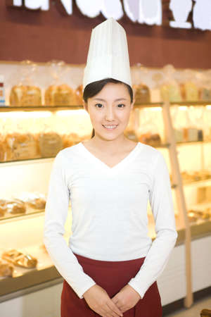 The happy bakery saleswoman is in the bakery