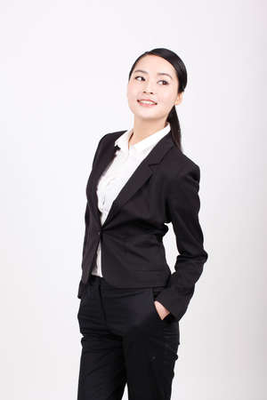 A young business woman in a suit high quality photo