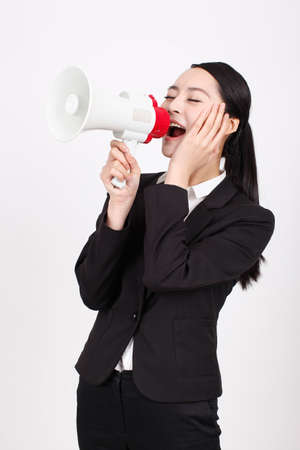 A young business woman holding a megaphone high quality photo