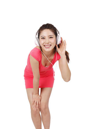 Young woman in pink dress with headset high quality photo