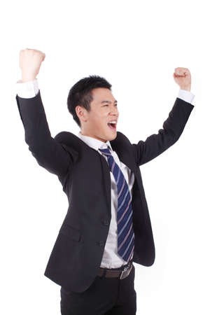 Businessman excited about his success in front of white background high quality photo