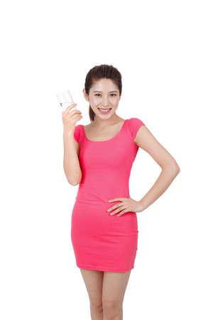 Young woman in pink dress holding a glass of water high quality photo Stock fotó