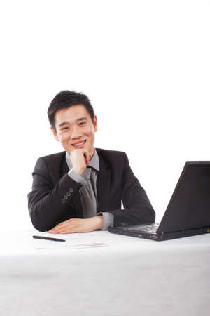 Asian young Business man using Laptop high quality photo
