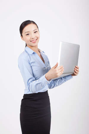 Smiling young business woman holding a laptop high quality photo Stock Photo