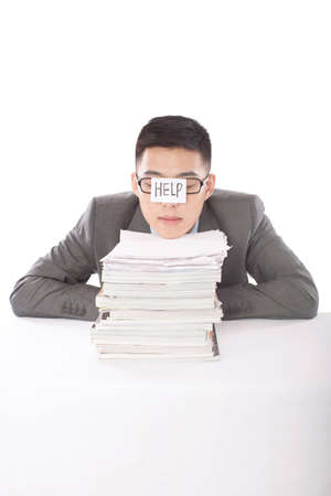 Portrait of young bisinessman leaning on stack of files high quality photo