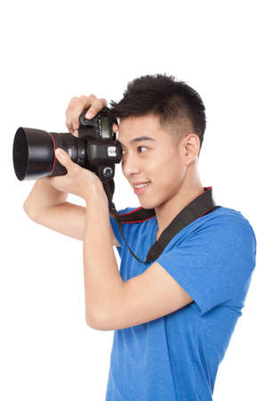 Portrait of a young Photographer holding camera high quality photo