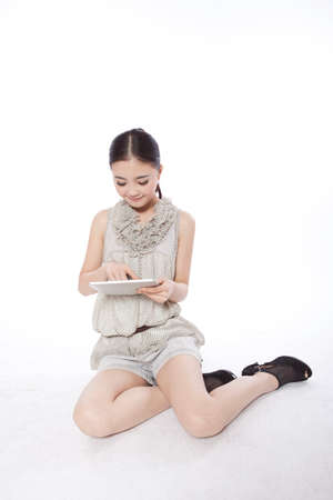 Portrait of a Young woman using tablet computer high quality photo