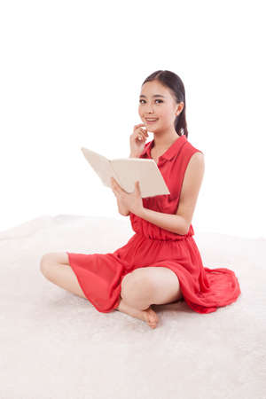 A Young woman reading in red dress high quality photo