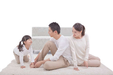 Portrait of daughter playing,parents sitting on carpet high quality photo