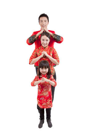 Portrait of daughter with parents in Tang suits paying New Year call,high view