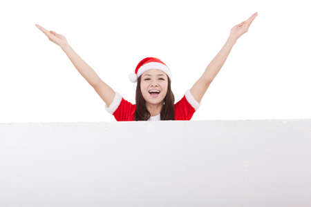 Portrait of young woman wearing santa hat,behind huge whiteboard