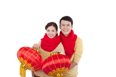 Portrait of young couple holding red lanterns,paying New Year call high quality photo