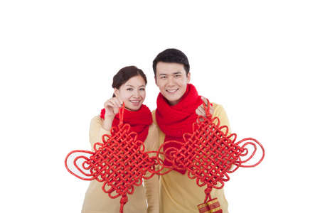 Portrait of young couple holding Chinese knots celebrating the Spring Festival high quality photo
