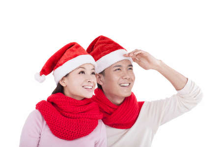 Portrait of young couple wearing Santa hats,smiling high quality photo