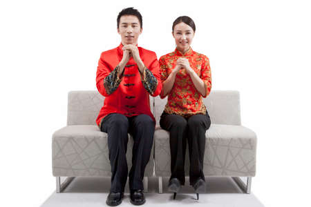 Portrait of young couple in Tang suits,paying New Year call high quality photo