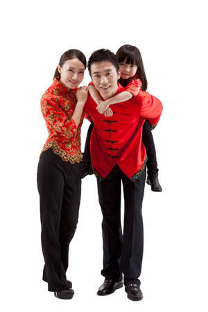 Portrait of family,father carrying daughter on back,in Tang suits high quality photo