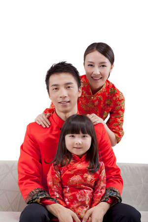 Portrait of daughter with parents in Tang suits high quality photo Banco de Imagens
