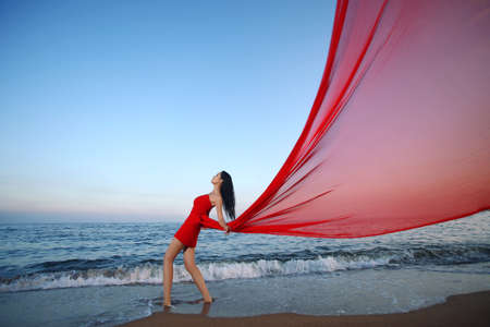 Portrait of Young woman by the sea high quality photo
