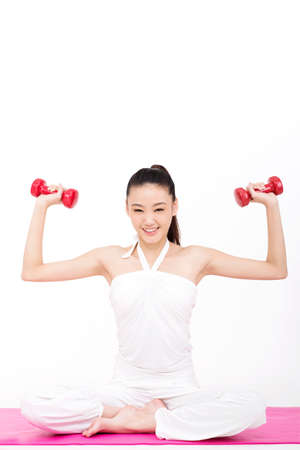 Young woman holding a dumbbell high quality photo