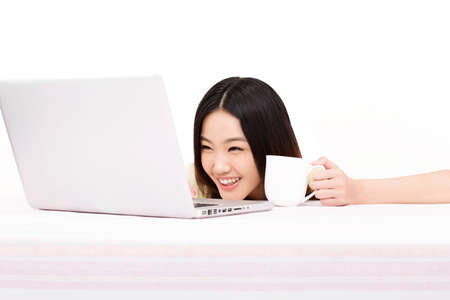 Young woman using computer high quality photo