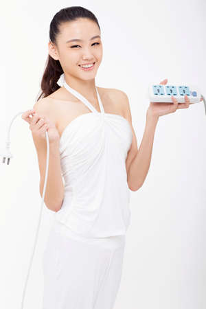 Young woman holding a socket high quality photo