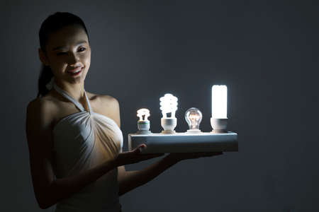 Young woman and a light bulb high quality photo