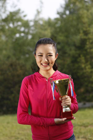 Young woman holding a trophy high quality photo