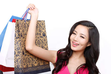 Fashion young woman holding shopping bags high quality photo