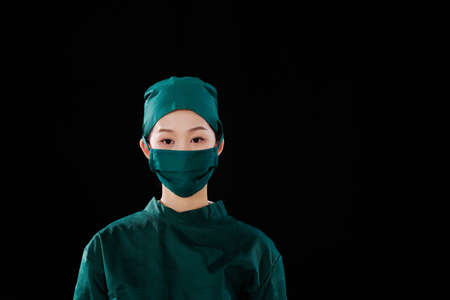 Portrait of a young female surgeon looking at the camera