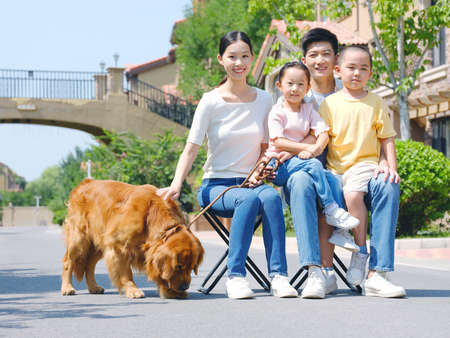 Happy family of four and pet dog in outdoor photo high quality photo
