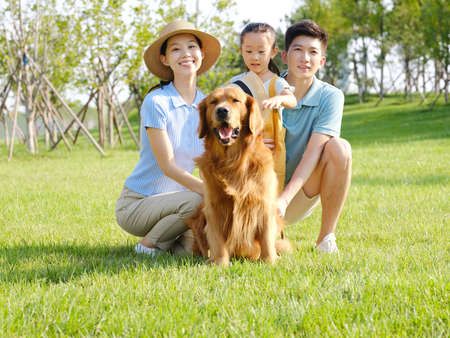 Happy family of three and pet dog in outdoor photo high quality photo