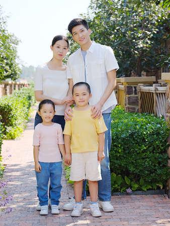Happy family of four in the outdoor group photo high quality photo